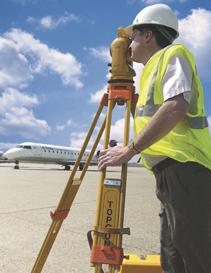 Worker surveying airfield
